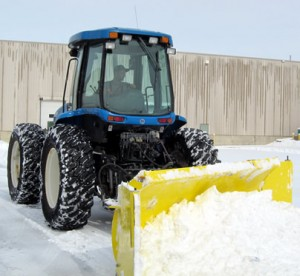Image of a large tractor plowing snow