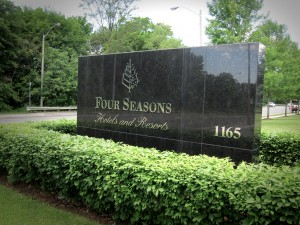 Photo of Four Seasons sign and shrubs